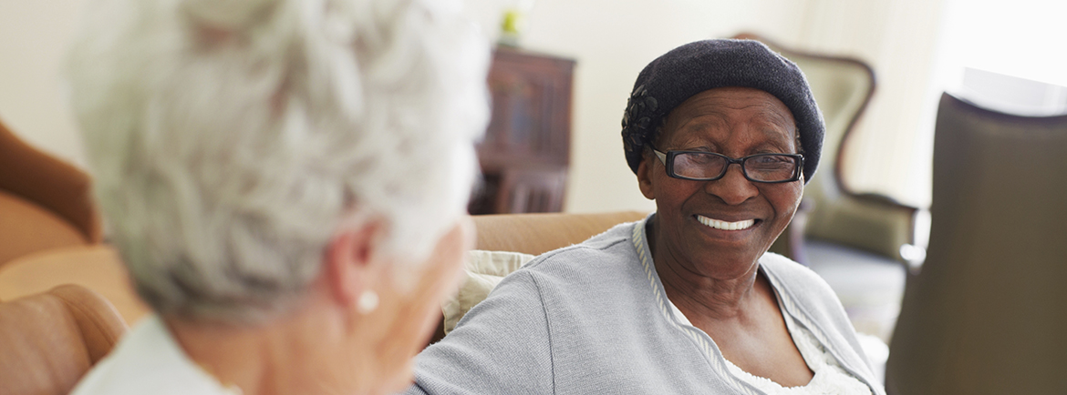 skilled nursing, seniors talking on couch